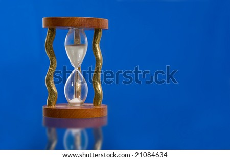 hourglass on color blue background