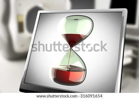 hourglass on monitor in laboratory - stock photo