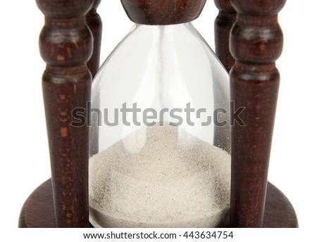 hourglass - sand passing through the glass bulbs of an hourglass measuring the passing time. - stock photo