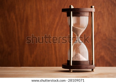 hourglass ,selective focus on center of sand glass - stock photo