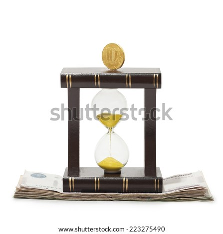 Hourglass with a coin on the Russian paper money, on a white background. - stock photo