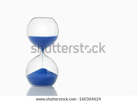 Hourglass with Blue Sand on White Background - stock photo