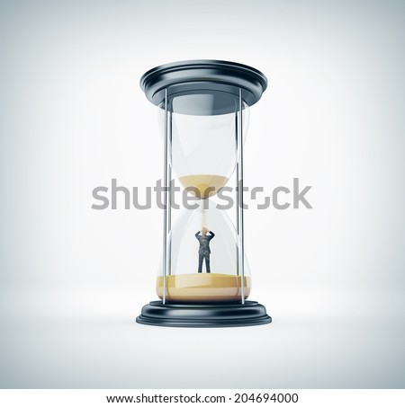 Hourglass with businessman inside - stock photo