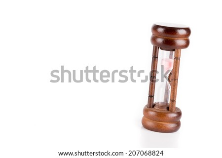 Hourglass with pink sand - stock photo