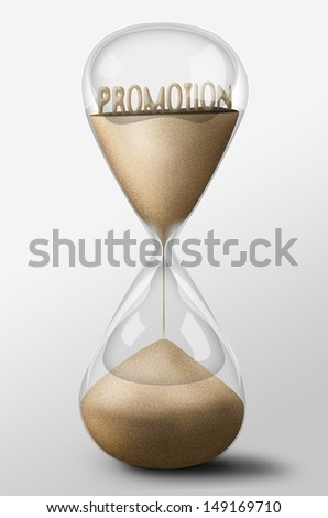 Hourglass with Promotion word made of sand inside the clock. Business concept