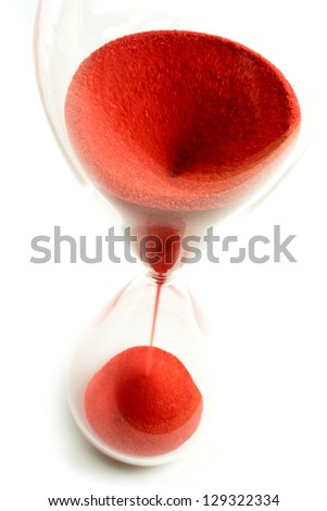 Hourglass with red sand and top view - stock photo