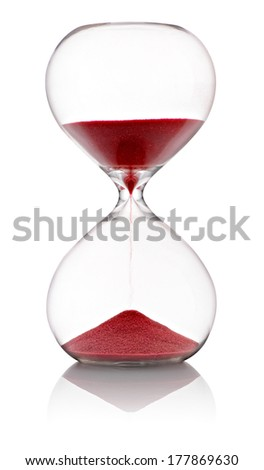 Hourglass with red sand running through the clear glass bulbs measuring the passing time