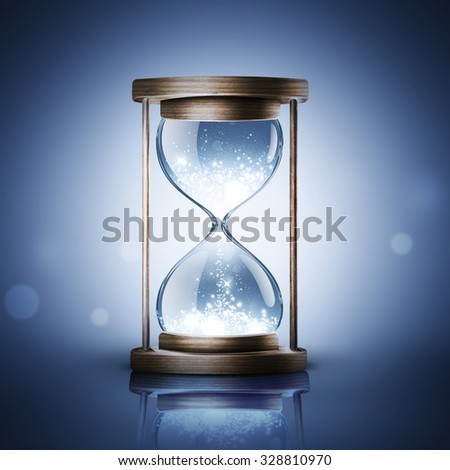 hourglass with shining light on dark blue background - stock photo