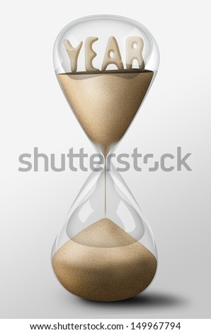 Hourglass with Year word made of sand inside the clock. Concept of passing time