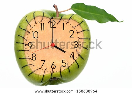Hours with shooters on a cut of ripe green apple - stock photo