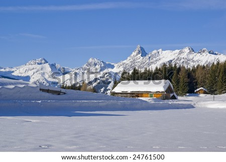Hous at the snowy mountains - stock photo