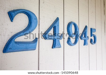 House address numbers attached to residential property - stock photo