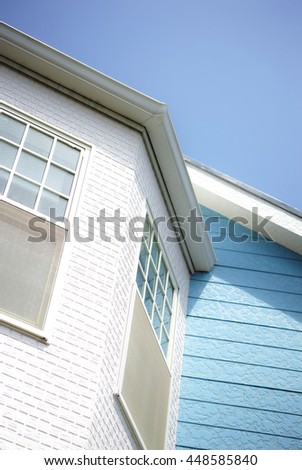 House against blue sky, vertical composition - stock photo