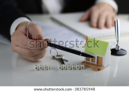House Agents hands a contract - stock photo