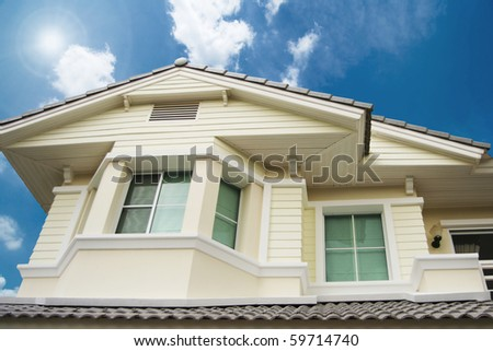 house and blue sky - stock photo