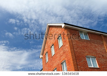 house and blue sky with copy space - stock photo