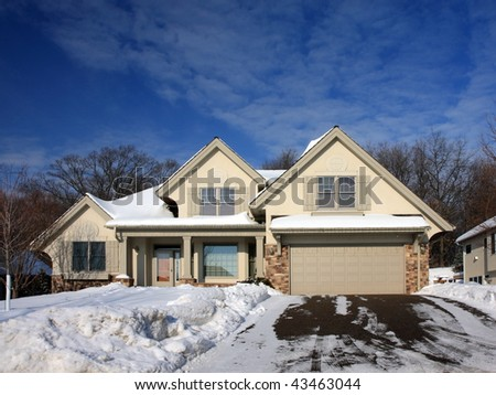 House and driveway at winter in Minnesota - stock photo