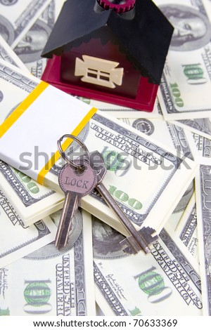 House and keys of one hundred dollar bills background - stock photo