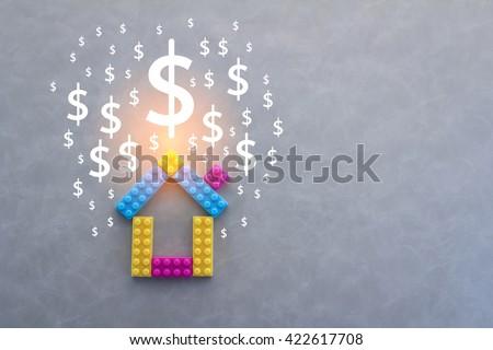 house and money symbol on grey background - stock photo