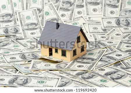 house and on dollars background