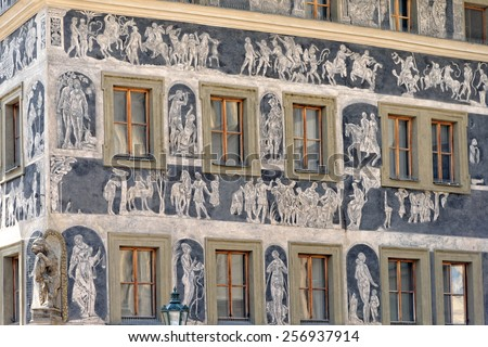"""House """"At the Minute"""" in Prague's Old Town Square, Czech Republic. It is a renaissance house decorated with sgraffiti, depicting Habsburg rulers. The writer Franz Kafka lived here. - stock photo"""