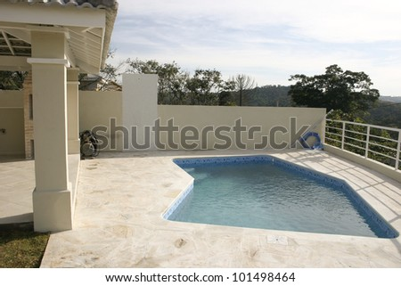 House backyard with a swimming pool