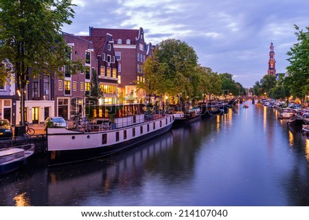 House Boats on the Prinsengracht Canal in Amsterdam, the Netherlands - stock photo