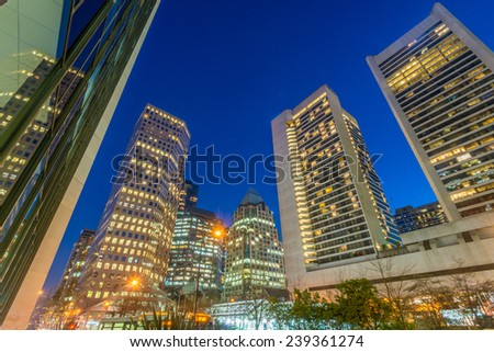 House building and city construction concept: evening outdoor urban view of modern real estate homes - stock photo