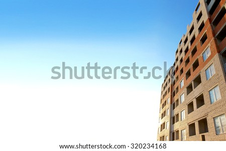 House building. Brick surface. Block wall with window, architecture under construction. Blue sky background. Built of home city. Concrete exterior apartments. Development.  - stock photo