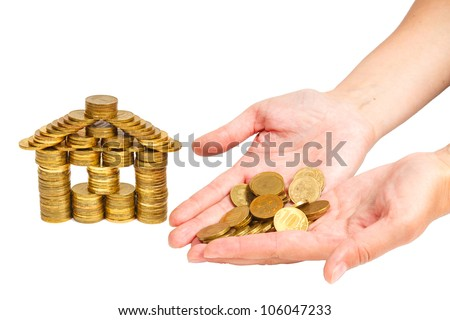 house built of coins female hand isolated on white background