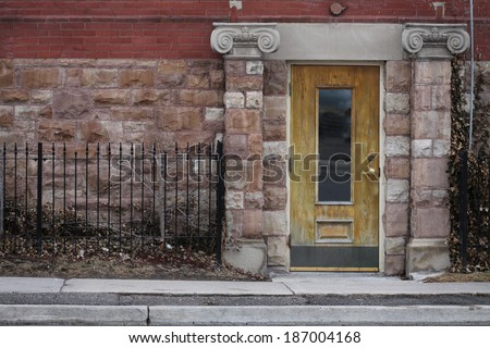 House built 1913 Whitby Ontario.  Plans by William A. Mahoney.  Side Entrance.  This historical building use to be the Whitby Public Library.  Now home to a Law Firm. - stock photo
