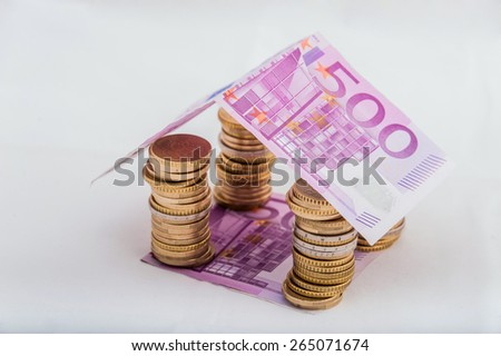 house built with money - stock photo