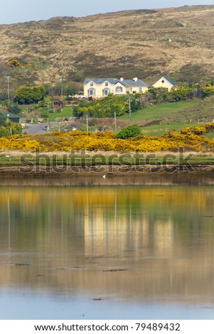 House by the lake in rural Ireland - stock photo
