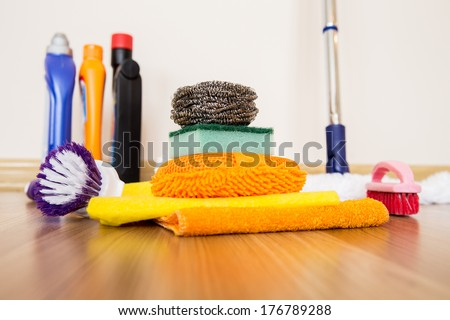 House cleaning -Cleaning accessories on floor room - stock photo