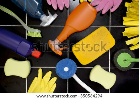 House cleaning product on tiled floor - stock photo