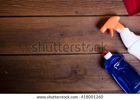House cleaning product on wood table, cleaning products, home work colorful theme - stock photo