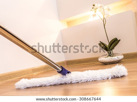 House cleaning supplies on a wooden floor for housekeeping service - stock photo