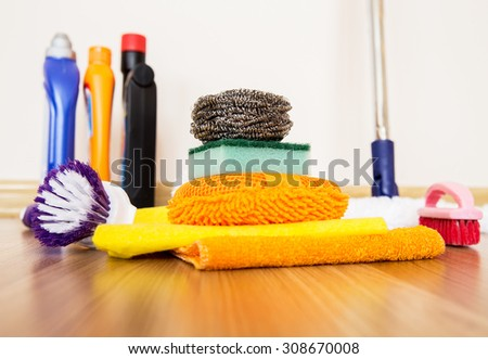 House cleaning supplies on a wooden floor for housekeeping service