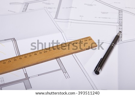 house construction plan for renovation of an old house, with pen and wooden ruler on blueprint - stock photo