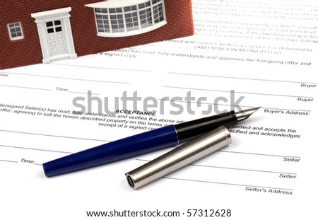 House Contract with model house sitting on contract - stock photo