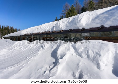 house covered and buried by snow  - stock photo