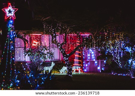 House decorated with lights for Christmas - stock photo