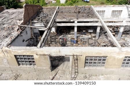 house demolishing - stock photo
