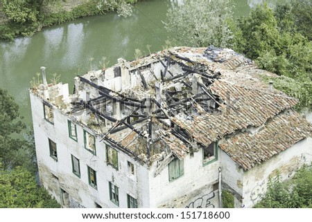House destroyed with broken roof tiles, construction and architecture - stock photo