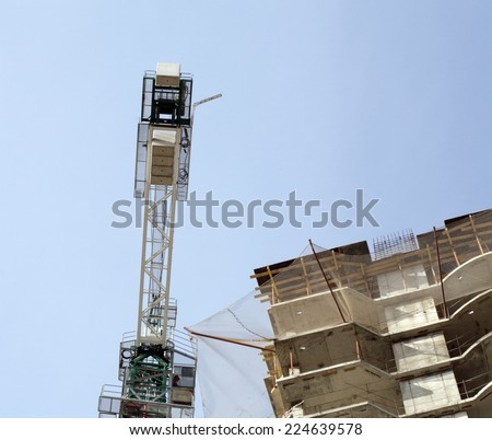 house develop with crane at day  - stock photo