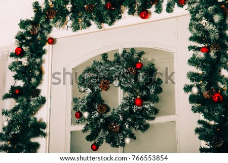 house entrance decorated for holidays. Christmas decoration. garland of fir tree branches