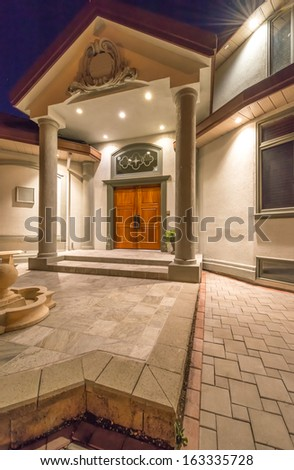 House entrance. Fragment of the big luxury house at night, disk, sunset, sunrise time in suburbs of Vancouver, Canada. - stock photo