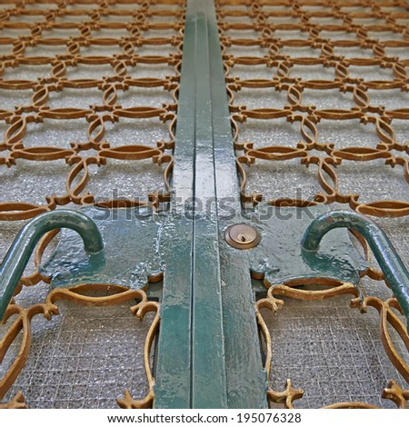 house entrance, old metallic door handles and grate detail - stock photo