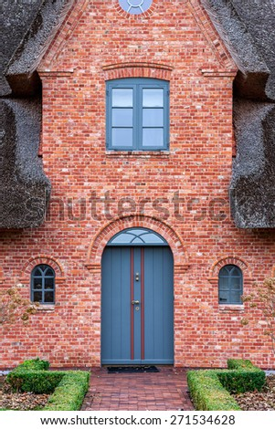 House entrance with blue door  - stock photo