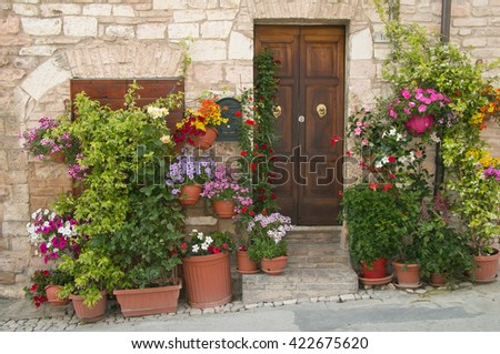 House entrance with plantpots in the old Spello village - stock photo